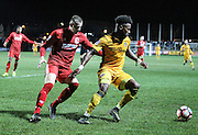 Jennison Myrie-Williams of Newport County and Brad McGowan of Alfreton Town during the The FA Cup match between Newport County and Alfreton Town at Rodney Parade, Newport, Wales on 15 November 2016. Photo by Andrew Lewis.