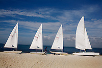 Boats line the beach of Nikoi, a private resort island near Bintan, Indonesia, on Monday, April 19, 2010.