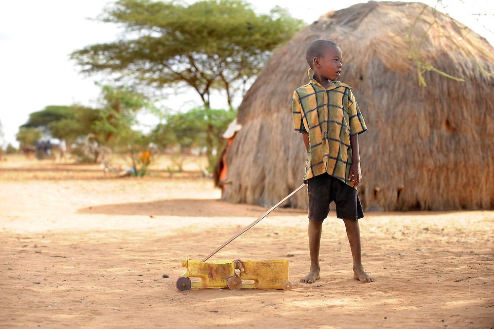 Mayow Yusuf Isack (7) wiht his truck made out of plastic containers at Belet Amin, a camp for internally displaced Somalis near the border with Kenya. The camp was set up for people fleeing the fighting in Somalia in 1997. 26/6/2008