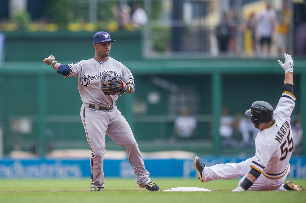 PITTSBURGH, PA - JUNE 08: Jean Segura #9 of the Milwaukee Brewers attempts to complete a double play as Russell Martin #55 of the Pittsburgh Pirates slides into second base during the game against the Pittsburgh Pirates at PNC Park on June 8, 2014 in Pittsburgh, Pennsylvania. (Photo by Rob Tringali) *** Local Caption *** Jean Segura;Russell Martin