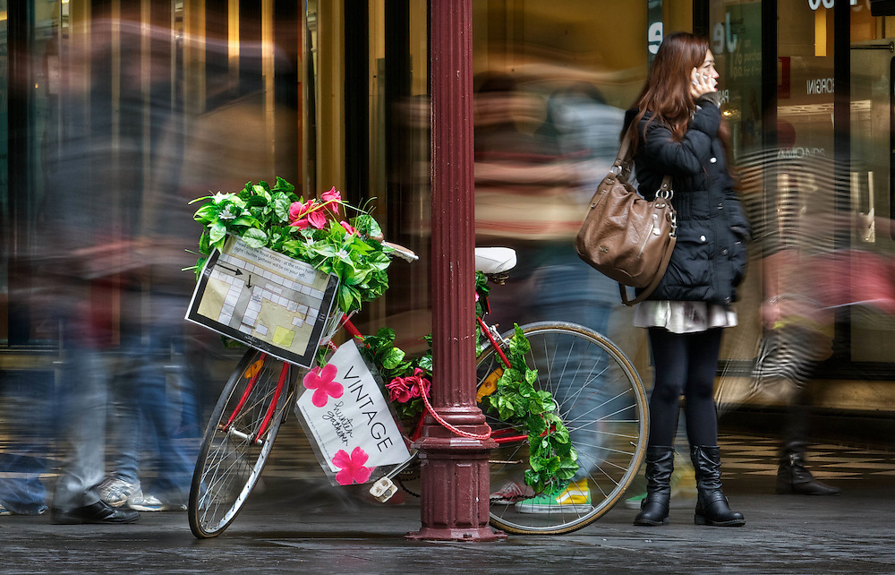 BEST VERSION. Modern Melbourne #21. All the rage in street advertising is to dress up an old bike with flowers &amp; the name &amp; location of your store, pictured in Bourke St Mall. Pic By Craig Sillitoe CSZ / The Sunday Age 27/07/2012 melbourne photographers, commercial photographers, industrial photographers, corporate photographer, architectural photographers, This photograph can be used for non commercial uses with attribution. Credit: Craig Sillitoe Photography / http://www.csillitoe.com<br />