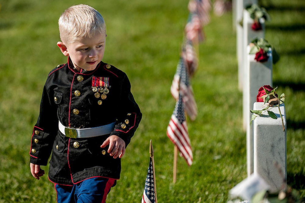 On Memorial Day, Christian Jacobs, 3, of Hertford, North Carolina, walks along the headstones in Section 60, where his father, Marine Sgt. Christopher Jacobs is buried at Arlington National Cemetery in Arlington, Virginia, USA, on 26 May 2014.