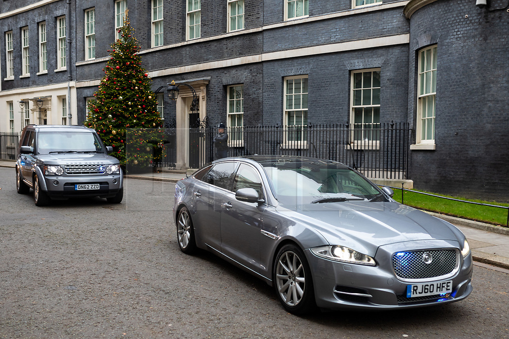 © Licensed to London News Pictures. 12/12/2018. London, UK. A car containing British Prime Minister Theresa May leaves 10 Downing Street, as the Prime Minister goes to attend Prime Minister's Questions in the Houses of Parliament, after announcing this morning that she will contest tonight's vote of no confidence in her leadership. Overnight, 48 letters were handed in triggering the vote of no confidence. Photo credit : Tom Nicholson/LNP
