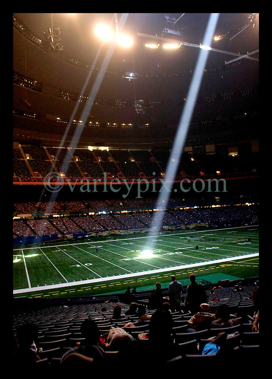 30th August, 2005. Hurricane Katrina, New Orleans, Louisiana. Light streams through storm damage holes in the ceiling inside the New Orleans Saints' Superdome where as many as 20,000 refugees take shelter.