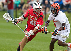 Maryland Terrapins Midfield Jeff Reynolds (28) is defended by Virginia Cavaliers M  Shamel Bratton  (1).  The #9 ranked Maryland Terrapins fell to the #1 ranked Virginia Cavaliers 10 in 7 overtimes in Men's NCAA Lacrosse at Klockner Stadium on the Grounds of the University of Virginia in Charlottesville, VA on March 28, 2009.
