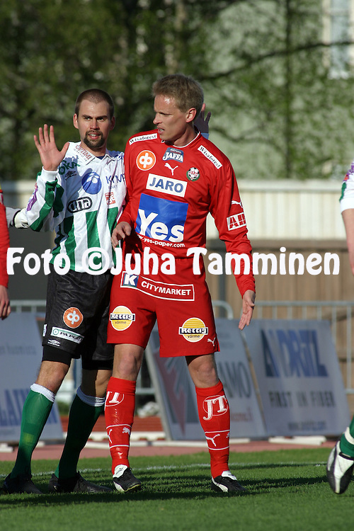 10.05.2004, Keskuskentt?, Pietarsaari, Finland..Veikkausliiga 2004 / Finnish League 2004.FF Jaro v FC KooTeePee.Anssi Vir?n (KooTeePee) v Vesa Vasara (Jaro).©Juha Tamminen