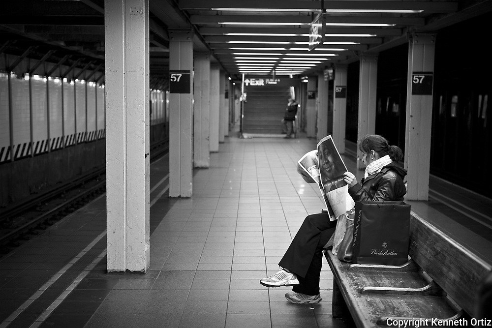 A woman waits for her train at the 57th Street subway station in mid-town Manhattan.