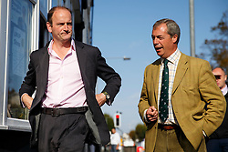 © Licensed to London News Pictures. 09/10/2014. Clacton, UK. Douglas Carswell, UKIP MP candidate for Clacton-on-Sea and Nigel Farage visit UKIP campaign office in Clacton-on-Sea during the by-election on Thursday, 9 October, 2014. Photo credit : Tolga Akmen/LNP