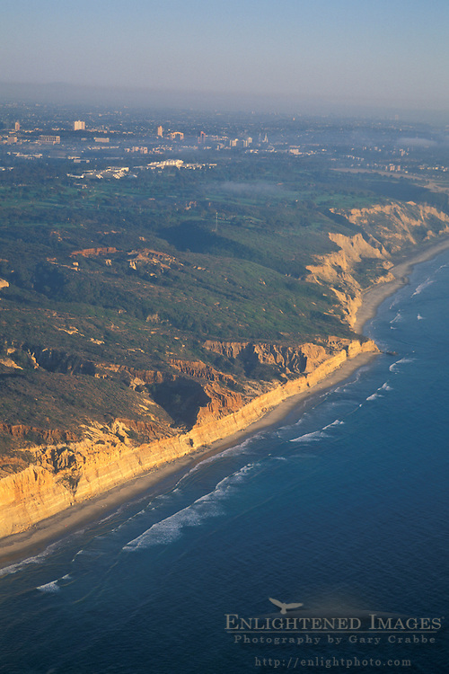 Aerial of coastal cliffs at sunset near Torrey+Pines, Northern San Diego Coastline San Diego County, CALIFORNIA