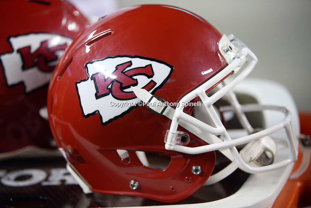Kansas City Chiefs helmets sit on sideline equipment trunks during the Kansas City Chiefs NFL week 4 regular season football game against the New England Patriots on Monday, September 29, 2014 in Kansas City, Mo. The Chiefs won the game 41-14. ©Paul Anthony Spinelli