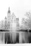 Nederland, Vught, 20140402.<br /> Infrarood opname voormalig gemeentehuis Vught. <br /> rijksmonument met cultuurhistorische waarde. Prachtig wit kasteeltje gelegen aan een vijver. Het gras en de bladeren zijn wit gekleurd door het infrarood effect. Het jonge groen bevat veel chlorofyl dat het infrarode licht sterk weerkaatst. En daardoor wit lijkt op de foto<br /> <br /> Netherlands, Vught, 20,140,402. <br /> Infrared image of the former town hall in Vught. <br /> monument with cultural and historical value. Beautiful white castle located on the edge of a pond. The grass and the leaves are white due to the infrared effect.<br /> Young green contain a lot of chlorophyll that reflects the infrared light strongly. And therefore appears white in the picture