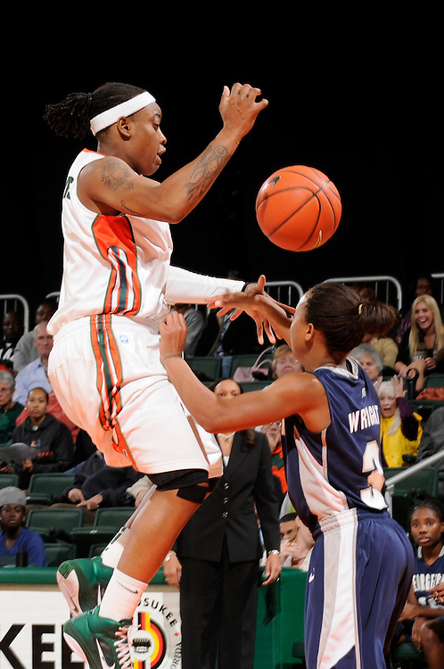December 7, 2010: Rubylee Wright of the Georgetown Hoyas fouls Riquna Williams of the Miami Hurricanes during the NCAA basketball game between Georgetown and Miami. The 'Canes defeated the Hoyas 81-72.