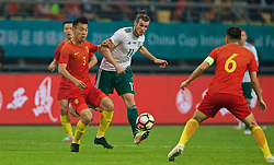 NANNING, CHINA - Thursday, March 22, 2018: Wales' Gareth Bale and China's Zheng Zheng during the opening match of the 2018 Gree China Cup International Football Championship between China and Wales at the Guangxi Sports Centre. (Pic by David Rawcliffe/Propaganda)