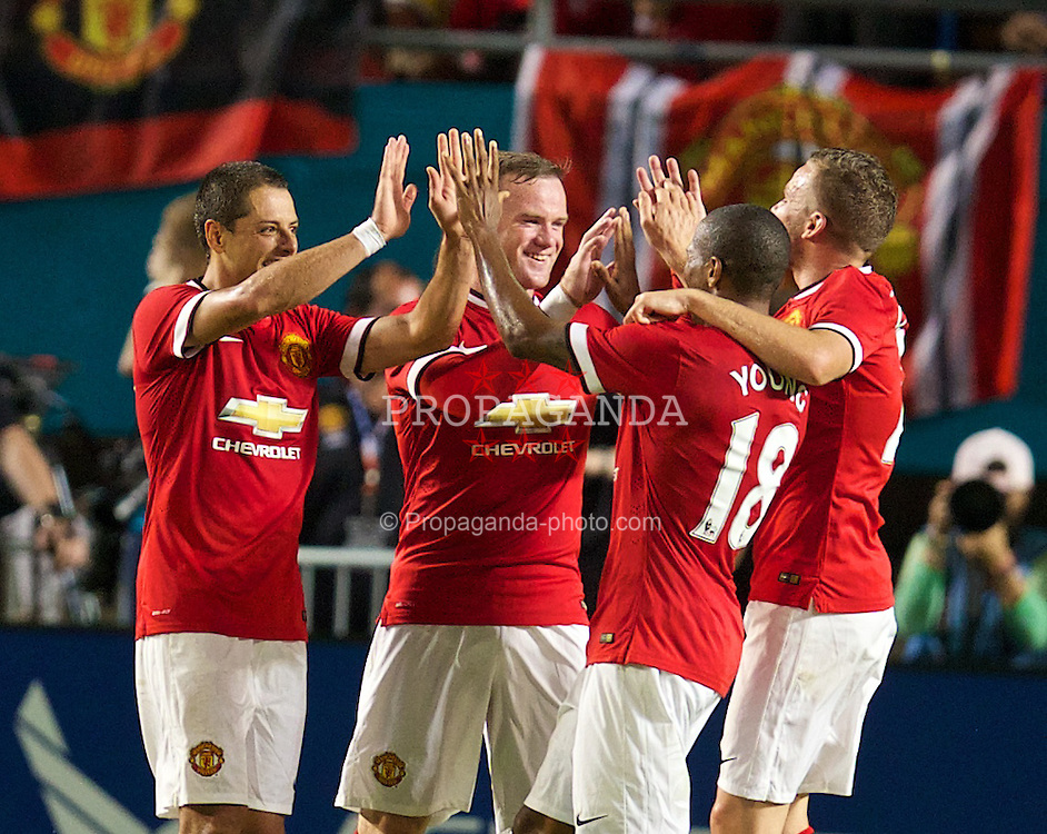 MIAMI, USA - Monday, August 4, 2014: Manchester United's Wayne Rooney celebrates what he thinks is the third goal, but the ball went out of play, during the International Champions Cup Final match against Liverpool at the SunLife Stadium on day fifteen of the club's USA Tour. (Pic by David Rawcliffe/Propaganda)