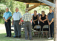 Reverend Jimmy Adkins leads the final A Copella Hymn before  tables are setup and dinner in served at Holbrook Family Reunion or Church in Morgan County KY