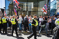 London, UK. 14 May, 2019. Supporters of former English Defence League leader Tommy Robinson gather outside the Old Bailey before his appearance to face a hearing before two High Court judges for an allegation of contempt of court.