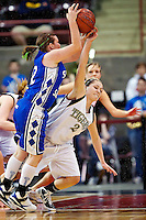 Timberlake High's Kara Wenstrom reaches up to knock the ball away as she falls in front of Kimber Choffin from Sugar-Salem High during the second half of the 3A state basketball championship game at the Idaho Center in Nampa.
