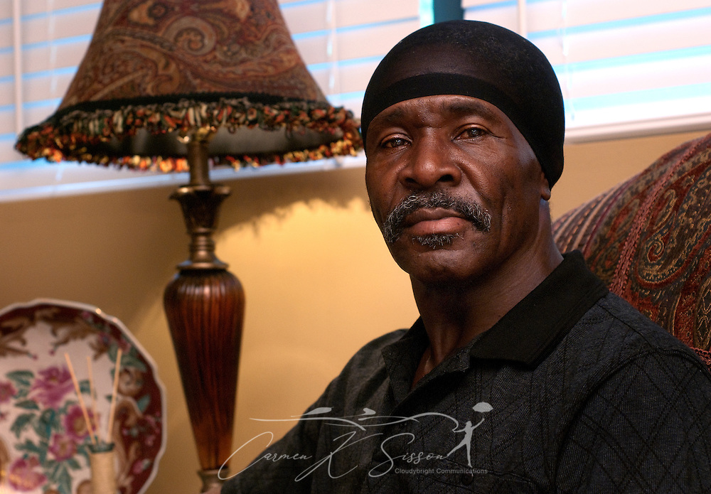 Johnny Holley Jr. relaxes in his living room in Tuscaloosa, Ala. May 8, 2009. Holley, 63, was released from prison in April after serving 29 years of a life without parole sentence for armed robbery in the first degree. Holley, who was sentenced under the three strikes law for stealing a toolbox in 1980, was allowed to go free following the Alabama Legislature's 2000 decision to ease mandatory sentences for non-violent, repeat offenders. (Carmen K. Sisson/Cloudybright)