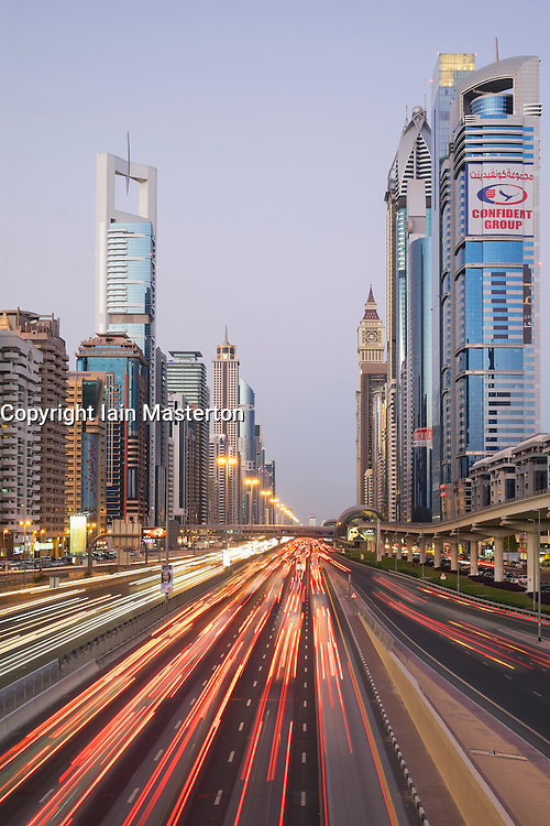 Evening view of skyscrapers and traffic along Sheikh Zayed Road in Dubai United Arab Emirates.