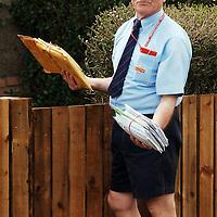 Britain's Got Talent contestant Susan Boyle from Blackburn, West Lothian media interest continues...Pic shows the postman delivering Susan Boyle's fan mail to her house in Yule Terrace in Blackburn, West Lothian...Picture Richard Scott/Maverick