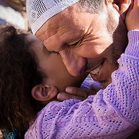 We were warmly welcomed at this small village nestled high up in the Atlas Mountains. The kids came out on the street welcoming us, waving with their little hands and on their faces, charming smiles. This young girl recognized her grandfather who was one of the guides. He immediately called her and she did not hesitate to run over and give him a big hug and a kiss.