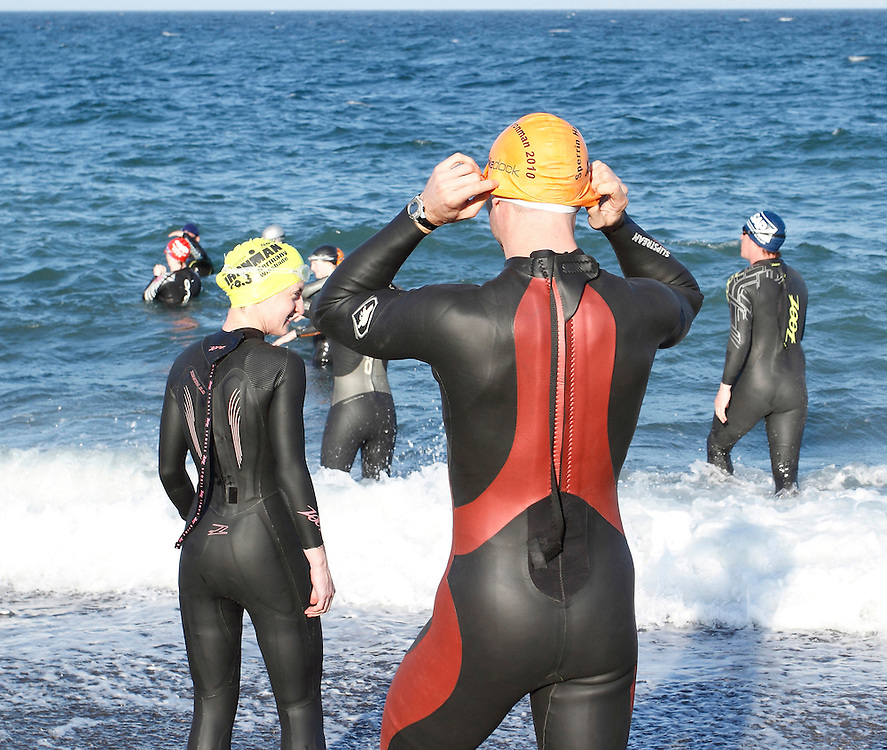 Aoife and Joe Lynch, Irish Triathletes with team members from the Pulse Triathlon Club at a swim training session on Killiney beach, Dublin.