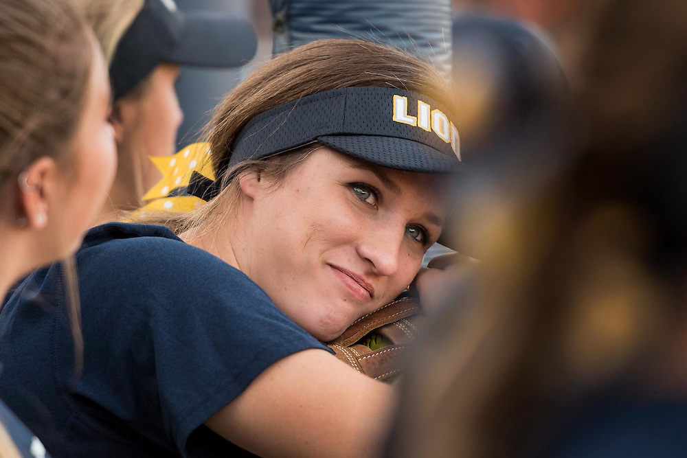 A Vanguard University softball player sits in the dugout during a softball game at Cal State Fullerton in Fullerton, Calif., on Friday November 4, 2016 (© Kurt Stoffer/Sport Shooter Academy 2016)