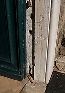 An engraving on a stone door frame marks the high water level of the 1966 flood in Venice, Italy