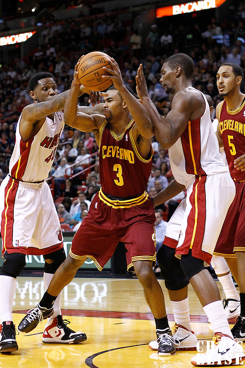 24 January 2012: Miami Heat power forward Udonis Haslem (40) and Miami Heat power forward Chris Bosh (1) defend on Cleveland Cavaliers point guard Ramon Sessions (3) during the Miami Heat 92-85 victory over the Cleveland Cavaliers at the AmericanAirlines Arena, Miami, Florida, USA.