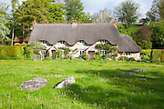 Two historic semi-detached thatched cottages at Lockeridge village, Wiltshire, England