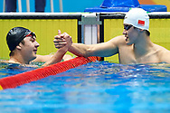 Ashgabat, Turkmenistan - 2017 September 24: (R) Peng Wang from People's Republic of China and (R) Artyom Kozluk from Uzbekistan thank each other after Men's 50m Butterfly Final while Short Course Swimming competition during 2017 Ashgabat 5th Asian Indoor & Martial Arts Games at Aquatics Centre (AQC) at Ashgabat Olympic Complex on September 24, 2017 in Ashgabat, Turkmenistan.<br /> <br /> Photo by © Adam Nurkiewicz / Laurel Photo Services