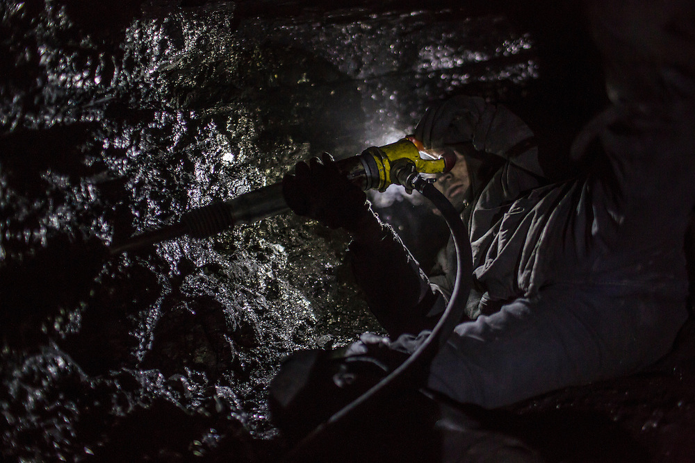 SNEZHNE, UKRAINE - JANUARY 25, 2015: Ivan, who provided only his first name out of concern for the fact that such mines were illegal until recently, digs coal at the bottom of a small private coal mine in Snezhne, Ukraine. The mine produces approximately 15 tons of coal per day with a crew of four men. CREDIT: Brendan Hoffman for The New York Times