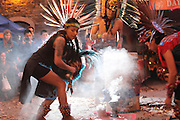 New York, New York. November 1, 2013. Yadira dancers in the smoke of the incense. Her dance group, Kalpulli Atl-Tlachinolli performed at a Dia De Los Muertos celebration outside St. Mark's Church in the Bowery. 11012013. Photo by Maya Rajamani/NYCity Photo Wire