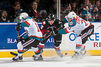 KELOWNA, CANADA - MARCH 1: Devante Stephens #21 of the Kelowna Rockets checks Kody McDonald #26 of the Prince George Cougars on MARCH 1, 2017 at Prospera Place in Kelowna, British Columbia, Canada.  (Photo by Marissa Baecker/Shoot the Breeze)  *** Local Caption ***
