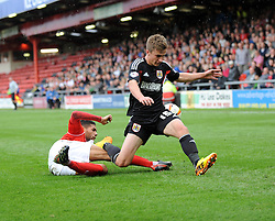 Bristol City's Joe Bryan is tackled by Crewe Alexandra's Kevin Mellor - Photo mandatory by-line: Dougie Allward/JMP - Tel: Mobile: 07966 386802 19/10/2013 - SPORT - FOOTBALL - Alexandra Stadium - Crewe - Crewe V Bristol City - Sky Bet League One