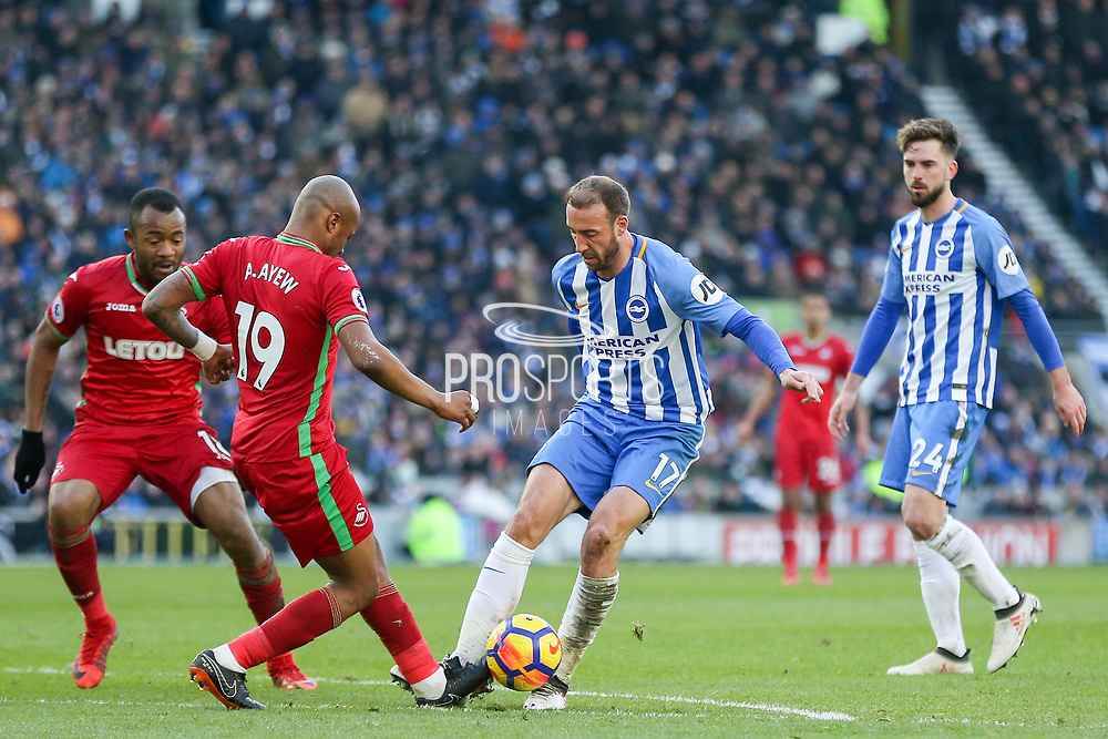 Swansea City striker Andre Ayew (19) tackles Brighton and Hove Albion forward Glenn Murray (17) during the Premier League match between Brighton and Hove Albion and Swansea City at the American Express Community Stadium, Brighton and Hove, England on 24 February 2018. Picture by Phil Duncan.