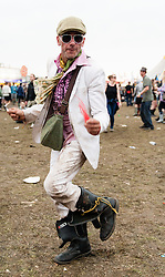 © Licensed to London News Pictures. 30/08/2015. Reading, UK.  A festival goer dances at Reading Festival 2015 while listening to Jamie T performing on Day 3 Sunday.  Photo credit: Richard Isaac/LNP