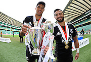 LONDON, ENGLAND - Sunday 11 May 2014, Akira Ioane and Sherwin Stowers of New Zealand pose with the London 7's trophy as well as the HSBC Series winners trophy after they beat Australia 52-33 in the final of the Marriott London Sevens rugby tournament held at Twickenham Rugby Stadium in London as part of the HSBC Sevens World Series.<br /> Photo by Roger Sedres/ImageSA