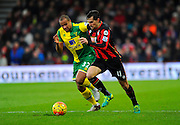 Norwich City midfielder Vadis Odjidja-Ofoe and AFC Bournemouth midfielder Charlie Daniels during the Barclays Premier League match between Bournemouth and Norwich City at the Goldsands Stadium, Bournemouth, England on 16 January 2016. Photo by Graham Hunt.
