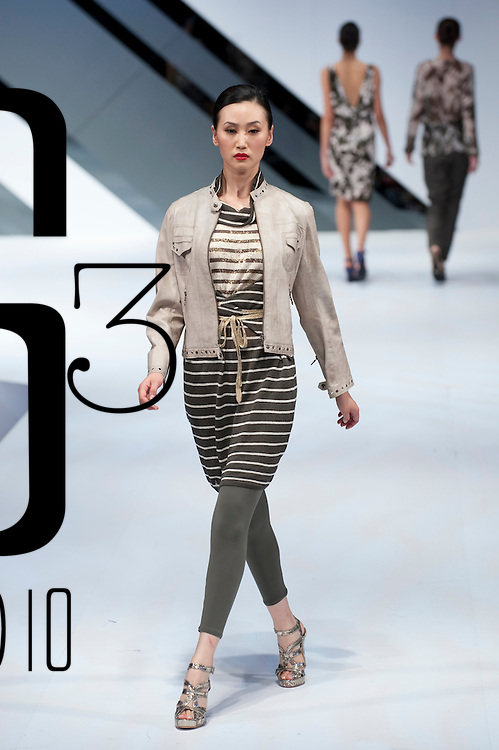 HONG KONG - JANUARY 18:  A model showcases designs by William Tang on the catwalk during the Marccain show as part of the  Hong Kong Fashion Week Fall/Winter 2010 on January 18, 2010 in Hong Kong.  Photo by Victor Fraile / studioEAST