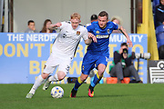 AFC Wimbledon midfielder Dean Parrett (18) battles for possession with Northampton Town forward Luke Williams (35) during the EFL Sky Bet League 1 match between AFC Wimbledon and Northampton Town at the Cherry Red Records Stadium, Kingston, England on 11 March 2017. Photo by Matthew Redman.