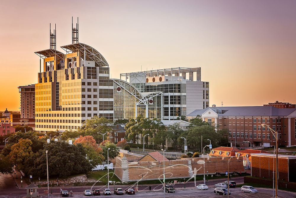 The sun sets on Government Plaza, November 27, 2015, in Mobile, Alabama. The building, erected in 1994 at a cost of $73 million, is 325 feet tall and is the first structure in the country to combine county and municipal governments and the court system in one space. It is the 10th tallest building in Alabama. The building was renamed in 2013 to honor outgoing mayor Sam Jones. The building is now officially named Samuel L. Jones Government Plaza. (Photo by Carmen K. Sisson/Cloudybright)