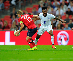England's Raheem Sterling (Liverpool) battles for the ball with Norway's Per Ciljan Skjelbred  - Photo mandatory by-line: Joe Meredith/JMP - Mobile: 07966 386802 - 3/09/14 - SPORT - FOOTBALL - London - Wembley Stadium - England v Norway - International Friendly