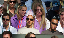 29.06.2011, Wimbledon, London, GBR, ATP World Tour, Wimbledon Tennis Championships, im Bild Formula one race driver Lewis Hamilton and half-brother Nicolas, with tennis player Sabine Lisicki behind, during the Gentlemen's Singles Quarter-Final match on day nine of the Wimbledon Lawn Tennis Championships at the All England Lawn Tennis and Croquet Club. EXPA Pictures © 2011, PhotoCredit: EXPA/ Propaganda/ David Rawcliffe +++++ ATTENTION - OUT OF ENGLAND/UK +++++