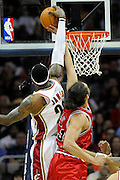 Apr 27, 2010; Cleveland, OH, USA; Cleveland Cavaliers forward LeBron James (23) blocks the shot of Chicago Bulls center Joakim Noah (13) during the first period in game five in the first round of the 2010 NBA playoffs at Quicken Loans Arena.  Mandatory Credit: Jason Miller-US PRESSWIRE
