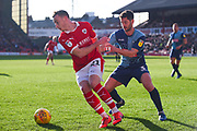 Joe Jacobson of Wycombe Wanderers (3) hassles Mike-Steven Bahre of Barnsley (21) in the penalty area during the EFL Sky Bet League 1 match between Barnsley and Wycombe Wanderers at Oakwell, Barnsley, England on 16 February 2019.