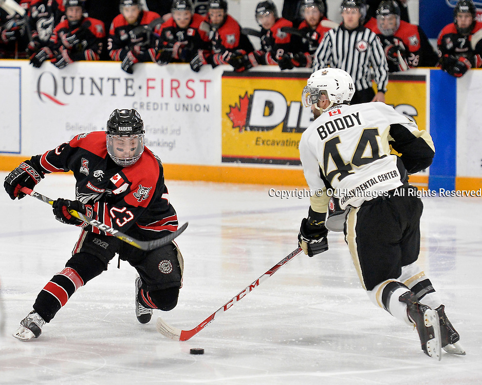 TRENTON, ON  - APR 23,  2017: Ontario Junior Hockey League, Championship Series.  Georgetown Raiders vs the Trenton Golden Hawks in Game 6 of the Buckland Cup Final.  Jack Jacome #23 of the Georgetown Raiders skates with the puck while being defended by Nick Boddy #44 of the Trenton Golden Hawks during the second period.<br /> (Photo by Shawn Muir / OJHL Images)