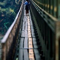Woman walking on bridge, Luang Phrabang, Laos