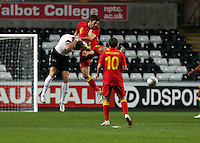 Pictured: Samuel Ricketts of Wales (C) chellenges Marc Janko of Austria (L) for a header. Wednesday 06 February 2013..Re: Vauxhall International Friendly, Wales v Austria at the Liberty Stadium, Swansea, south Wales.