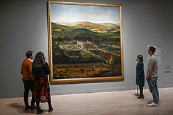 "© Licensed to London News Pictures. 03/02/2020. LONDON, UK. Staff members view ""View of Chatsworth"", 1699-1700, by Jan Siberechts. Preview of ""British Baroque : Power and Illusion"", the first ever exhibition to focus on baroque culture in Britain.  Works from the Restoration of Charles II in 1660 to the death of Queen Anne in 1714 are on display at Tate Modern 4 February to 19 April 2020, many on show to the public for the first time.  Photo credit: Stephen Chung/LNP"